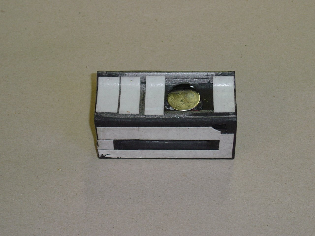 Top of card-reader showing battery.